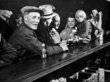 Dam Workers with Family Members Enjoying Beer at Local Bar