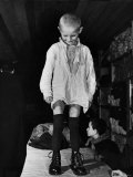 A Little Boy Receiving a Pair of New Boots and Clothing from Swiss Relief Workers