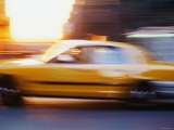 Blurred Motion of Taxi Cab on Busy Street in New York City