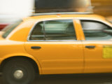 Blurred Motion of a Speeding Taxi Cab on a Busy Street