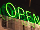 Green Neon Light in Reflective Store Window