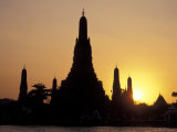 Sunset Behind Temple of Dawn on Chao Phraya River  Thailand