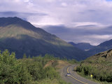 Car Drives on Road near Kluane Lake  Yukon  Canda