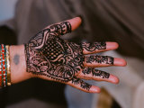 Hand of Indian Woman Decorated with Henna  India