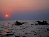 Silhouetted Boats on Lake Tanganyika  Tanzania