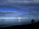 Silhouetted Woman on Lake Tanganyika  Tanzania