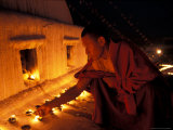 Monk Lighting Butter Lamps at Boudnath  Kathmandu  Nepal
