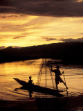 Intha Fisherman Rowing Boat With Legs at Sunset  Myanmar
