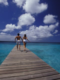 Couple Running on Dock  Curacao  Caribbean