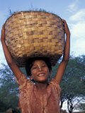 Girl with Painted Face Carrying Basket on Her Head  Myanmar