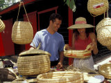 Couple Shopping for Baskets at Straw Market  Bahamas  Caribbean