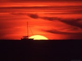 Sailboat Silhouetted Against the Sunset