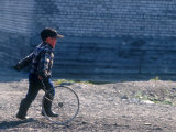 Young Boy Playing on the street of Uelen  Russia&#39;s Far East  Siberia
