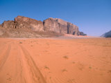 Jeep Tracks Across in Desolate Red Desert of Wadi Rum  Jordan