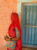 Portrait of Woman in Red Sari Against School Wall  Jodhpur  Rajasthan  India