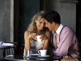 Young Couple Talking in Cafe