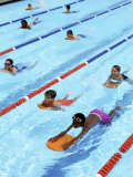 Children Learning to Swim