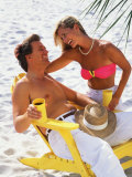Couple Relaxing on Beach with Lounge Chairs