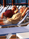 Retired Couple Lounging in Deck Chairs on a Cruise Ship