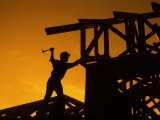 Construction Worker Silhouetted at Sunset
