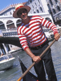 Gondolier Navigating a Gondola  Venice  Italy