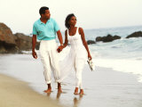 Black Couple Walking Together on the Beach