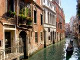 Gondolas along Canal  Venice  Italy
