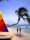Couple on Beach with Sailboat and Palm Tree  Barbados