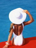 Young Woman in Swimsuit with Wide-Brimmed Hat