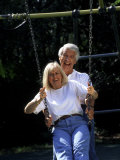 Healthy Couple in Park on Swing