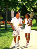 African American Couple Walking Together after Tennis Match