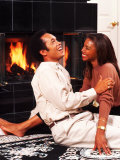 African-American Couple Sitting by the Fireplace