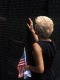 Woman at Vietnam Memorial  Washington DC  USA