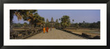 Two Monks Walking in Front of an Old Temple  Angkor Wat  Siem Reap  Cambodia