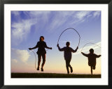 Silhouette of Children Jumping Rope Outdoors