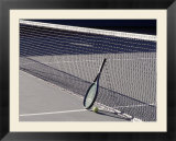 Tennis Racquet Against Net with Ball