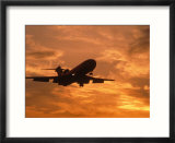 Silhouette of commercial airplane at sunset