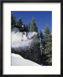 Airborne man on snowboard