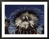 View from Behind of Blood Indians Wearing Tribal Feather Headdresses