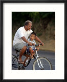 Father and Son Riding a Bicycle  Papeete  French Polynesia