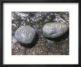 Rocks with the Words Imagine and Create in Water