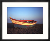 Colorful rowboat at sunset  Spain