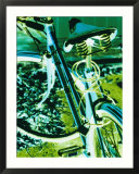 Bright blue and green colors create an electrifying view of a bicycle