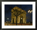 The famous Arc de Triomphe seen at night