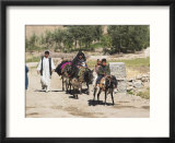 Aimaq People Walking and Riding Donkeys Entering Village  Between Chakhcharan and Jam  Afghanistan