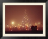 The National Christmas tree and visitors on a foggy night