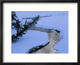 A twilight view of Baronette Creek winding through a snowy landscape