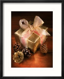 Christmas Gift with Gold Ribbon and Pinecones