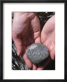Person Holding Rock with the Word Blessings