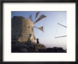 Woman Adjusting Sails of a Windmill  Olimbos  Karpathos  Greece